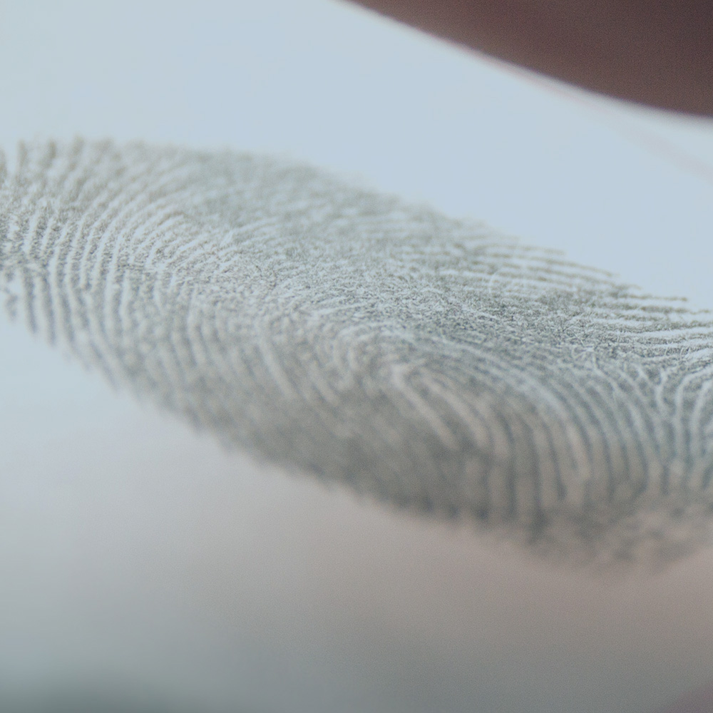 person taking a fingerprint