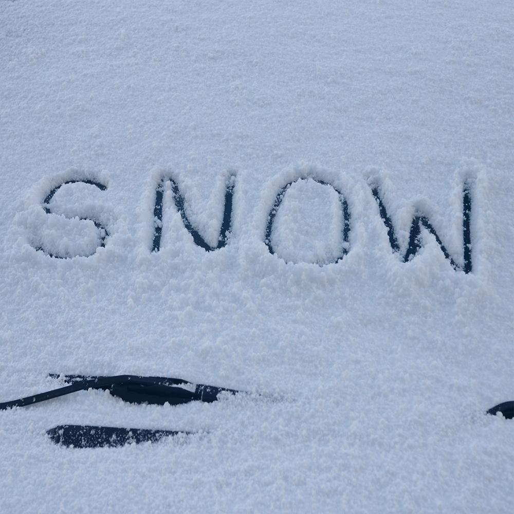 letters spelling snow written in snow